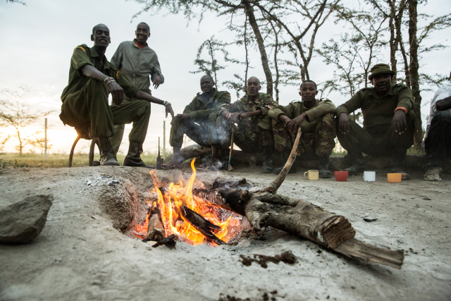 Caretakers and rangers at Ol Pejeta enjoy tea by the fire after the day shift.